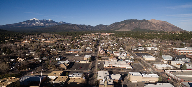 Aerial view over Flagstaff AZ looking north towards Humphreay's Peak in Coconino Natonal Forest